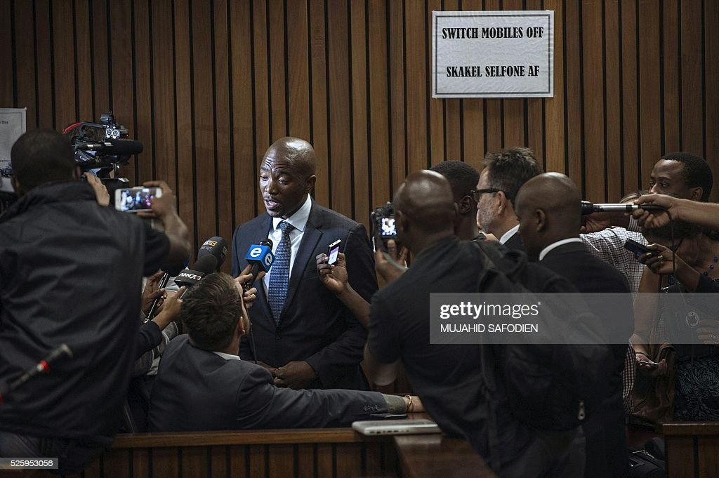 South Africa's main opposition party Democratic Allicance leader Mmusi Maimane talks to journalists after the Pretoria High court ruling on the decision that corruption chrages againts South African president Jacob Zuma could be re instated on April 29, 2016 in Pretoria. A South African judge delivered a damning verdict against prosecutors' decision to drop more than 700 corruption charges against President Jacob Zuma, piling further pressure on the embattled leader. / AFP / MUJAHID