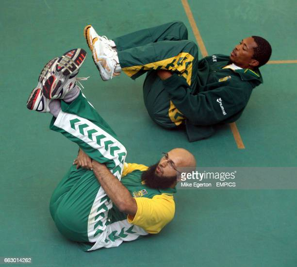 South Africa's Makhaya Ntini and Hashim Amla stretch during nets practice