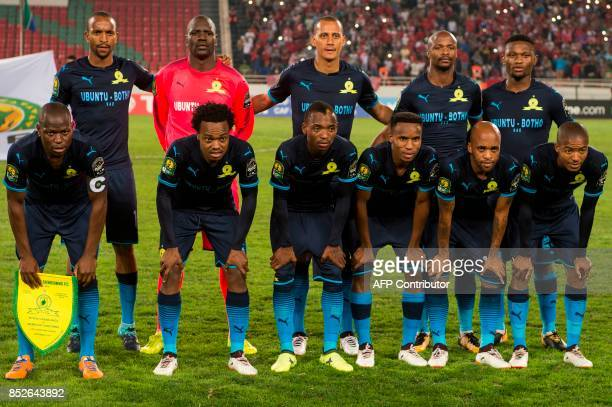 South Africa's Mamelodi Sundowns team pose before the CAF Champions League quarterfinal match against Morocco's Wydad Athletic Club at the Prince...