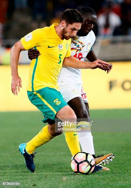 South Africa's midfielder Dean Furman vies for the ball with Senegal's defender Youssouf Sabaly during the FIFA 2018 World Cup Africa Group D...