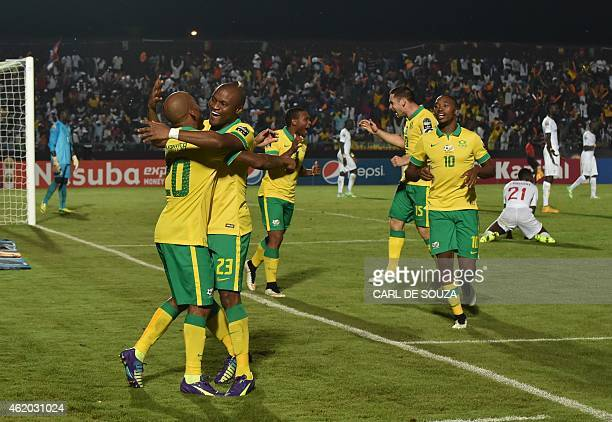 South Africa's midfielder Oupa Manyisa is congratulated by teammates after scoring a goal during the 2015 African Cup of Nations group C football...