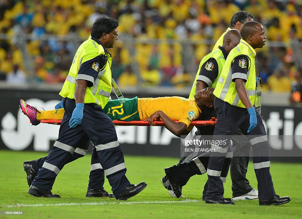 South Africa's midfielder Reneilwe Letsholonyane leaves the pitch on a stretcher during the extra-time of the African Cup of Nation 2013 quarter final football match South-Africa vs Mali, on February 2, 2013 in Durban. AFP PHOTO / BEN STANSALL