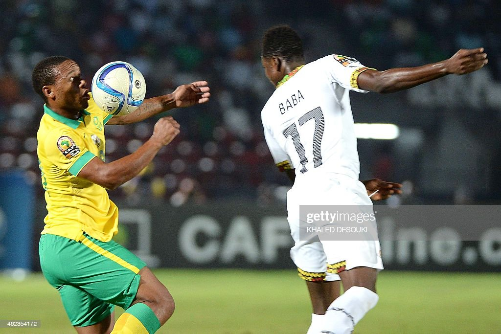 South Africa's midfielder <a gi-track='captionPersonalityLinkClicked' href=/galleries/search?phrase=Thuso+Phala&family=editorial&specificpeople=4422095 ng-click='$event.stopPropagation()'>Thuso Phala</a> (L) challenges Ghana's defender Abdul Rahman Baba during the 2015 African Cup of Nations group C football match between South Africa and Ghana in Mongomo on January 27, 2015. AFP PHOTO / KHALED DESOUKI