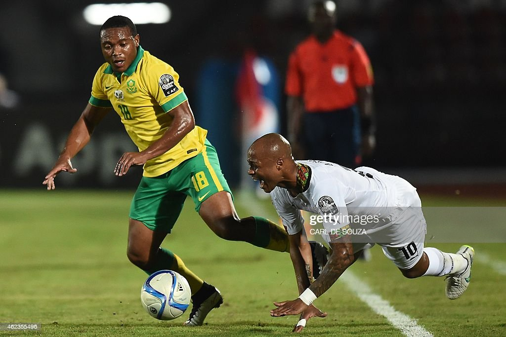 South Africa's midfielder <a gi-track='captionPersonalityLinkClicked' href=/galleries/search?phrase=Thuso+Phala&family=editorial&specificpeople=4422095 ng-click='$event.stopPropagation()'>Thuso Phala</a> (L) challenges Ghana's midfielder Andre Ayew during the 2015 African Cup of Nations group C football match between South Africa and Ghana in Mongomo on January 27, 2015. AFP PHOTO / CARL DE SOUZA