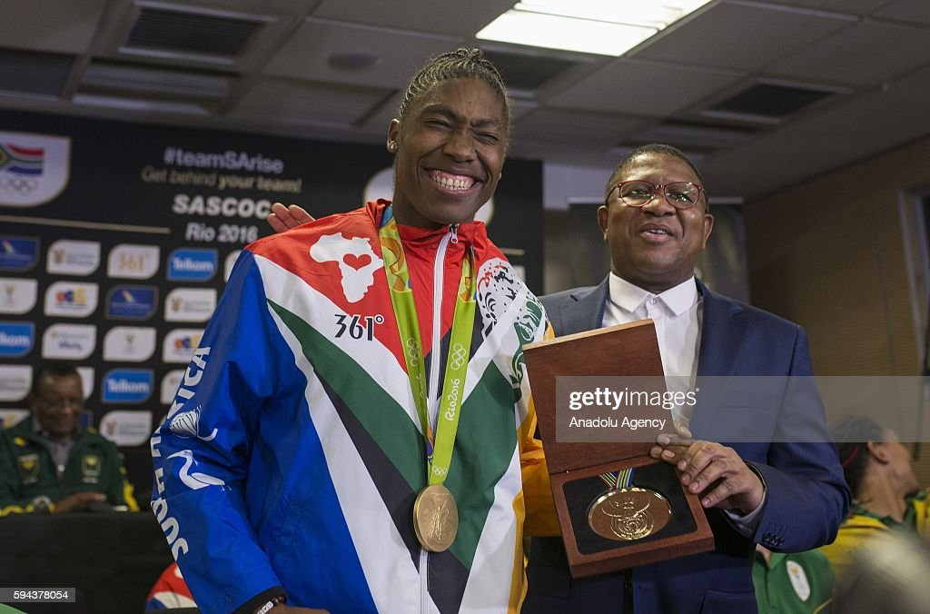 South Africa's Minister of Sport and Recreation Fikile Mbalula congratulates Caster Semenya (L), who won gold medal women's 800m in Rio 2016 Olympic Games, at O. R. Tambo International Airport in Gauteng province of Johannesburg, South Africa on August 23, 2016. South Africa team won two gold, six silver and two bronze medals in Rio 2016 Olympic Games.