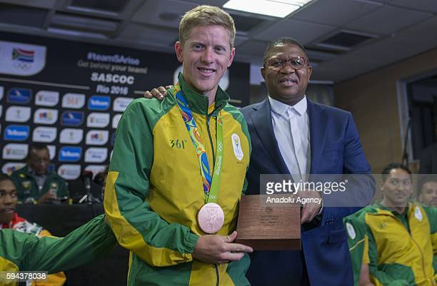 South Africa's Minister of Sport and Recreation Fikile Mbalula congratulates Henri Schoeman who won bronze medal in Men's individual Triathlon in Rio...