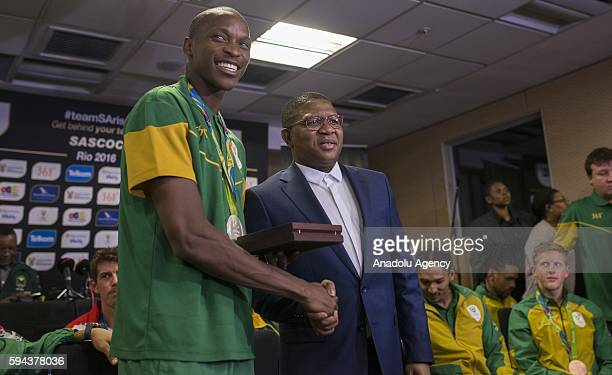South Africa's Minister of Sport and Recreation Fikile Mbalula congratulates Luvo Manyonga who won silver medal in Men's long jump in Rio 2016...