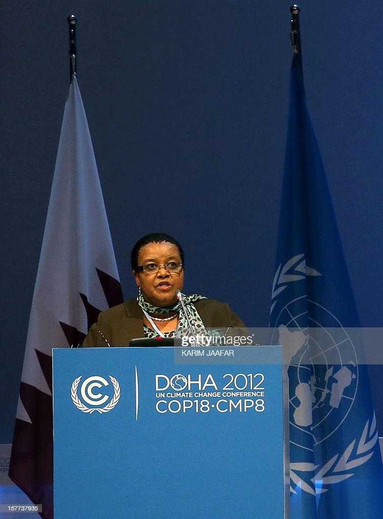 South Africa's Minister of Water and Environmental Affairs Bomo Molewa, addresses delegates during the penultimate day of the United Nations Framework Convention on Climate Change (UNFCCC) in the Qatari capital Doha, on December 6, 2012. Negotiators from nearly 200 countries entered the penultimate day of UN climate talks in Doha divided on near-term finance for poor nations' global warming mitigation plans. AFP PHOTO /KARIM JAAFAR / AL-WATAN DOHA == QATAR OUT ==
