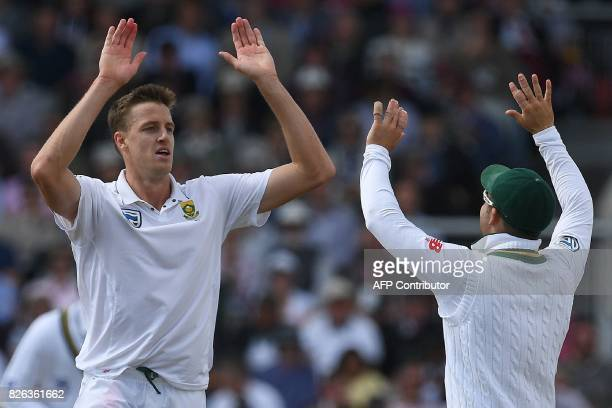 South Africa's Morne Morkel celebrates taking the wicket of England's Dawid Malan for 18 runs on the first day of the fourth test at Old Trafford...
