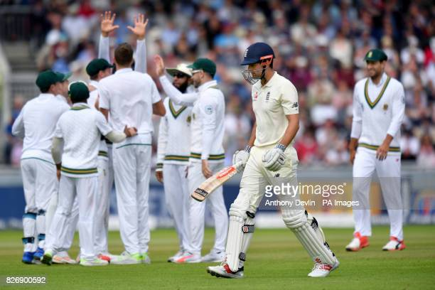 South Africa's Morne Morkel celebrates taking the wicket of England's Alastair Cook during day three of the Fourth Investec Test at Emirates Old...
