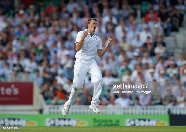 South Africa's Morne Morkel celebrates taking the wicket of England's Jonathan Trott for 71 runs during the Investec first test match at the Kia Oval...