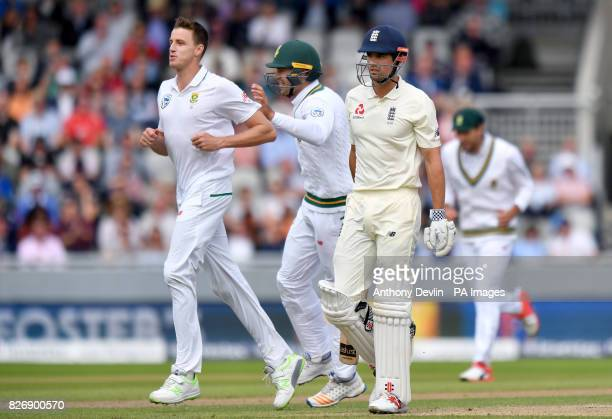 South Africa's Morne Morkel celebrates with Quinton de Kock after taking the wicket of England's Alastair Cook during day three of the Fourth...