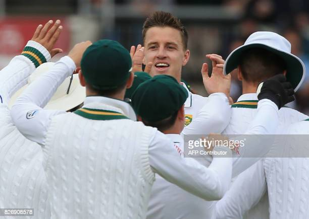South Africa's Morne Morkel celebrates with teammates the wicket of England's Tom Westley for 9 on the third day of the fourth Test match between...