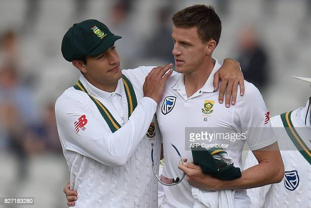 South Africa's Morne Morkel is congratulated by teammates after taking the wicket of England's James Anderson on day 4 of the fourth Test match...