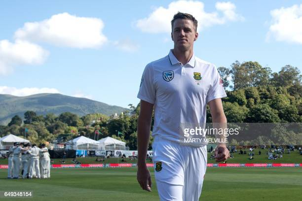 CORRECTION South Africa's Morne Morkel walks from the field after the national anthems during day one of the 1st International cricket test match...