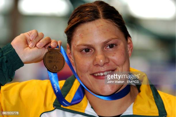 South Africa's Natalie Du Toit poses with her Gold medal for the Womens MD 50m Freestyle