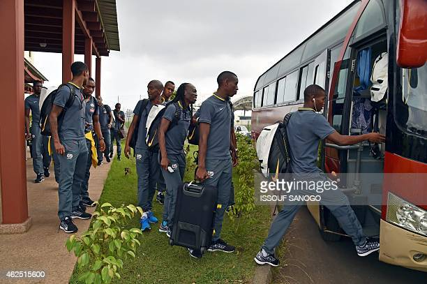 South Africa's national football team board a bus as they leave the hotel on their way to the airport in Malabo on January 30 after South Africa was...