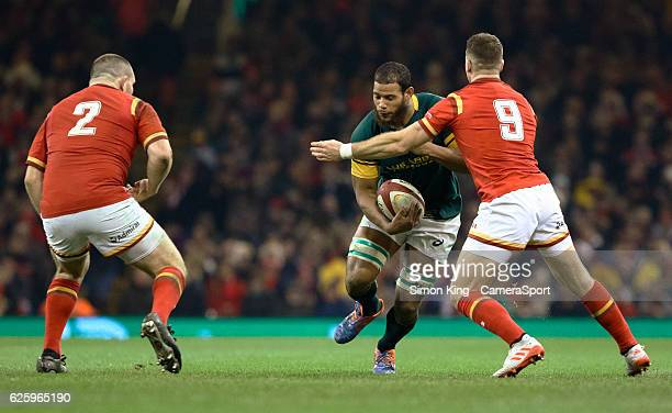 South Africa's Nizaam Carr under pressure from Wales' Gareth Davies during the International Friendly match between Wales and South Africa at...