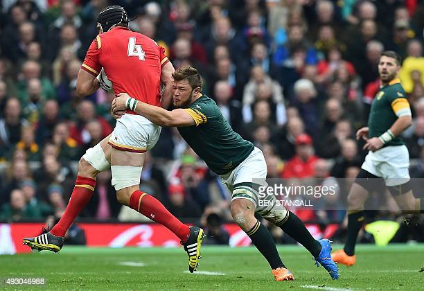 South Africa's number 8 Duane Vermeulen tackles Wales' lock Luke Charteris during a quarter final match of the 2015 Rugby World Cup between South...