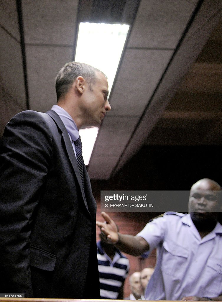 South Africa's Olympic sprinter Oscar Pistorius leaves the court room after his hearing on charge of murdering his model girlfriend Reeva Steenkamp on Valentine's Day, yesterday, on February 15, 2013 at the Magistrate Court in Pretoria. South African prosecutors will argue that Pistorius is guilty of premeditated murder in Steenkamp's death, a charge which could carry a life sentence.