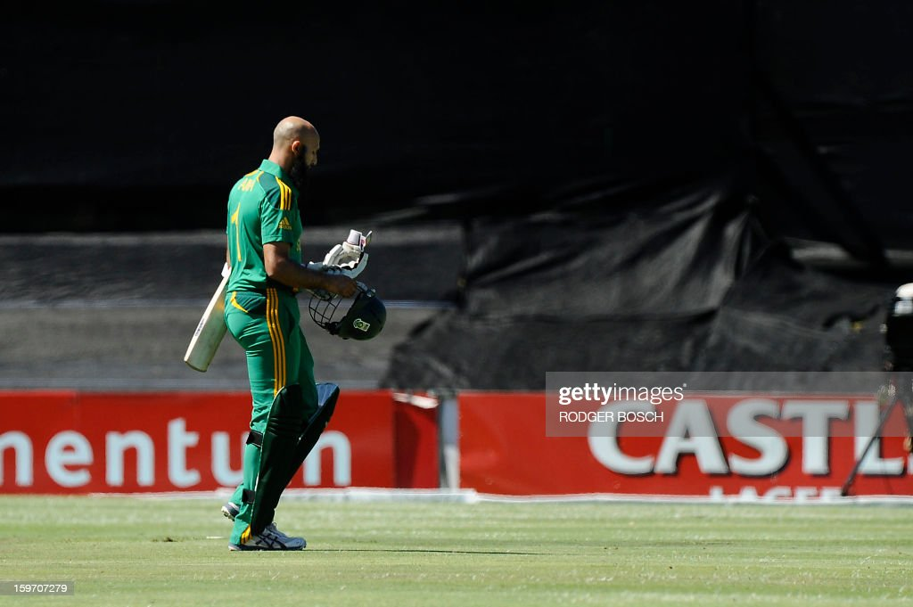 South Africa's opening batsman, Hashim Amla walks off the field after being caught LBW during the first One Day International (ODI) between South Africa and New Zealand on January 19, 2013 at Boland Park, in Paarl about 60Km North of Cape Town.