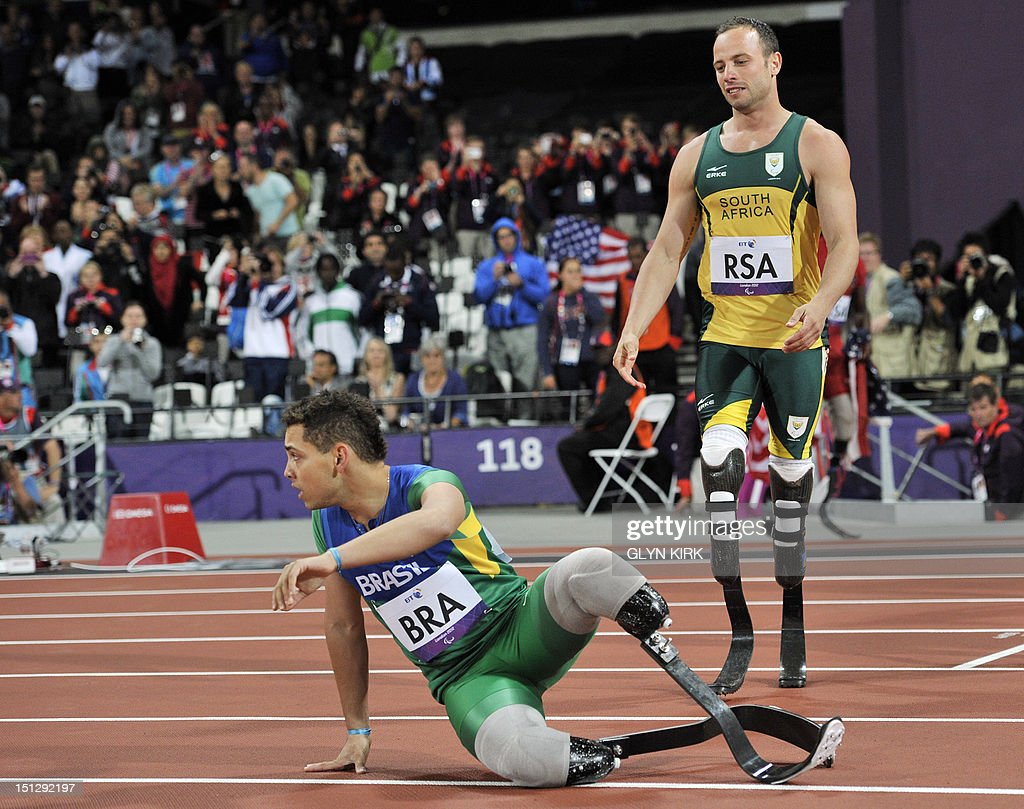South Africa's Oscar Pistorius (R) approaches Brazil's Alan Fonteles Cardoso Oliveira (L) after finishing the men's 4x100 metres relay T42-46 final during the athletics competition at the London 2012 Paralympic Games at the Olympic Stadium in east London on September 5, 2012. South Africa won in the world record time of 41.78, the team from Brazil were disqualified. AFP PHOTO / GLYN KIRK