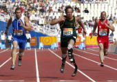 South Africa's Oscar Pistorius French Andre and Austria's Linhart run at semifinal of the Men's 100m T44 during the 12th Paralympic Games at the Main...