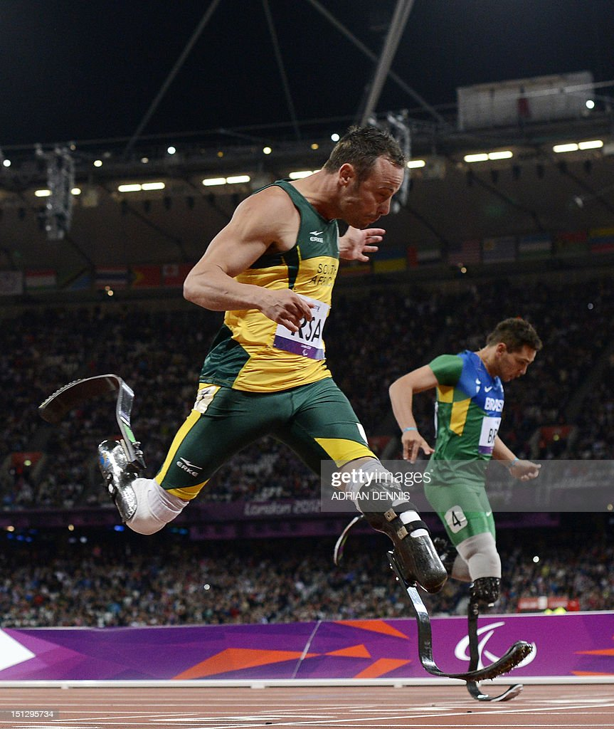 South Africa's Oscar Pistorius (L) runs through the finish line ahead of Brazil's Alan Oliveira (R) as he anchors his team home to win the men's 4x100 metres relay T42-46 final during the athletics competition at the London 2012 Paralympic Games at the Olympic Stadium in east London on September 5, 2012. South Africa won in the world record time of 41.78, while the Brazil team were disqualified.