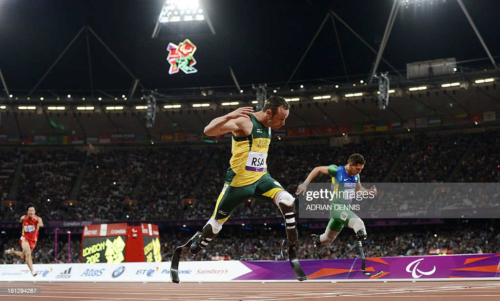 South Africa's Oscar Pistorius (2R) runs toward the finish line ahead of Brazil's Alan Oliveira (R) as he anchors his team home to win the men's 4x100 metres relay T42-46 final during the athletics competition at the London 2012 Paralympic Games at the Olympic Stadium in east London on September 5, 2012. South Africa won in the world record time of 41.78, while the Brazil team were disqualified.