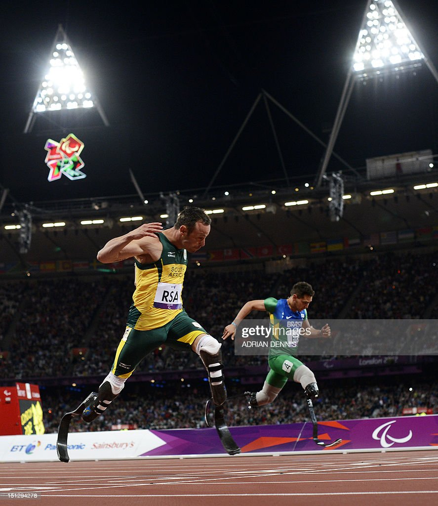 South Africa's Oscar Pistorius (L) runs toward the finish line ahead of Brazil's Alan Oliveira (R) as he anchors his team home to win the men's 4x100 metres relay T42-46 final during the athletics competition at the London 2012 Paralympic Games at the Olympic Stadium in east London on September 5, 2012. South Africa won in the world record time of 41.78, while the Brazil team were disqualified.
