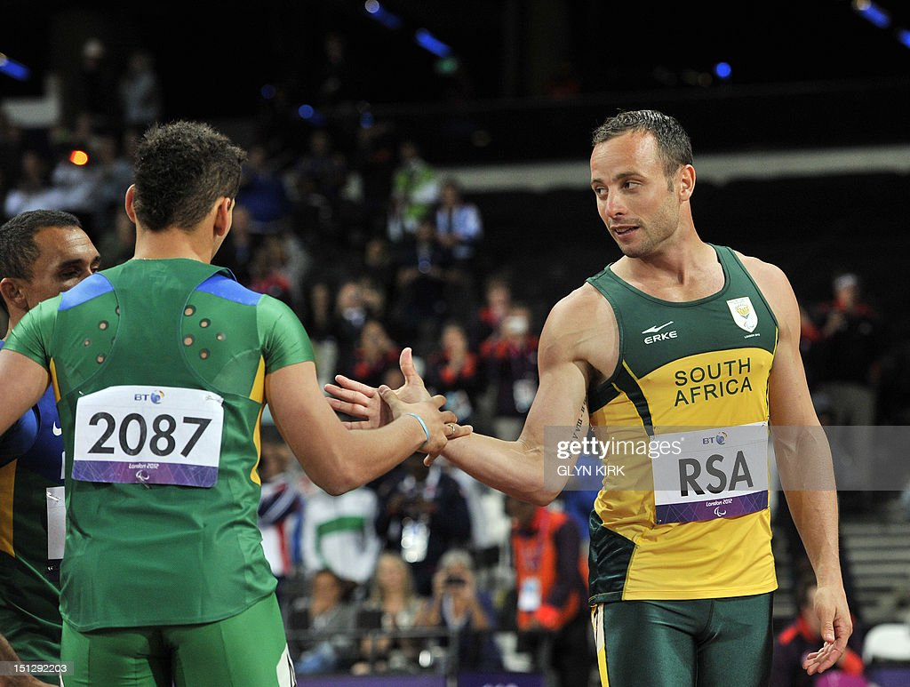 South Africa's Oscar Pistorius (R) shakes hands with Brazil's Alan Fonteles Cardoso Oliveira (L) after finishing the men's 4x100 metres relay T42-46 final during the athletics competition at the London 2012 Paralympic Games at the Olympic Stadium in east London on September 5, 2012. South Africa won in the world record time of 41.78, while the team from Brazil were disqualified.