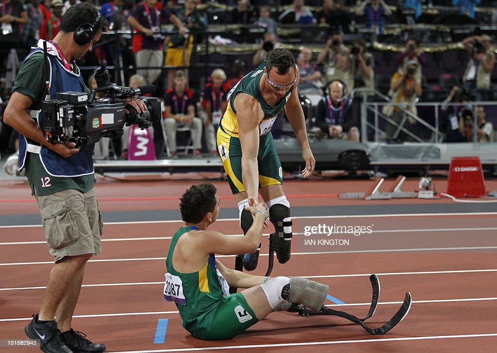 South Africa's Oscar Pistorius shakes hands with Brazil's Alan Fonteles Cardoso Oliveira after winning gold in the men's 400m - T44 final during the athletics competition at the London 2012 Paralympic Games at the Olympic Stadium in east London on September 8, 2012. Oliveira finished fourth.