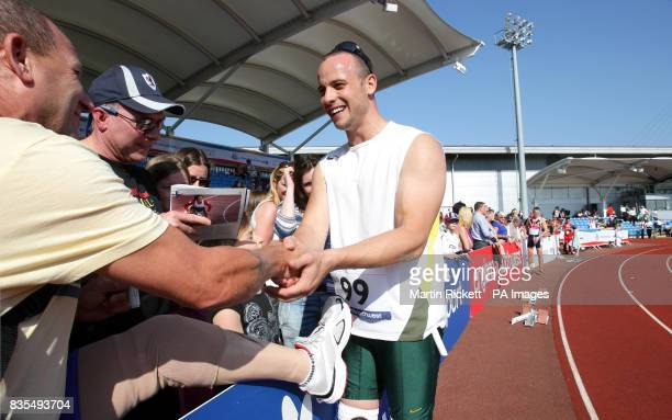 South Africa's Oscar Pistorius signs a prosthetic leg for a fan after winning gold in the Mens T44 400 Meters during the BT Paralympic World Cup...