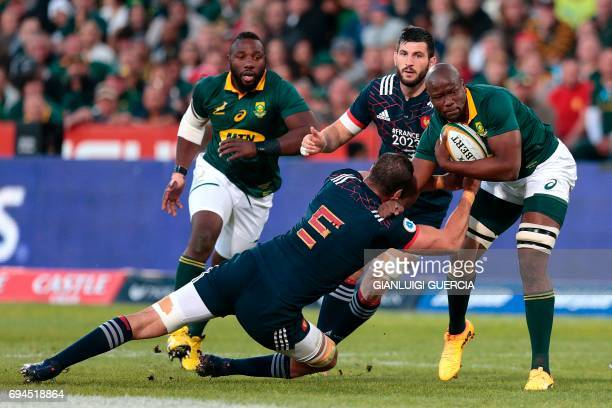 South Africa's Oupa Mohoje is tackled by France's Yoann Maestri during the first rugby union Test match between South Africa and France at the Loftus...
