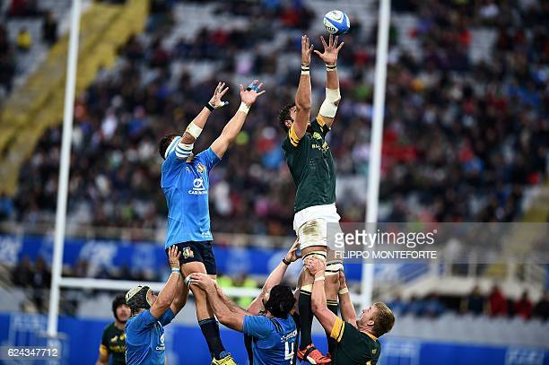 South Africa's player Lood de Jager jumps for the ball in front of Italy's Andries Van Schalkwyk during the rugby union Test match between Italy and...