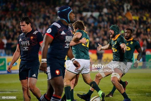 South Africa's players celebrate a try by South Africa scrum half Ross Cronje during the first rugby union Test match between South Africa and France...