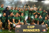 South Africa's players celebrate after winning the Final match between South Africa and New Zealand at the IRB Sevens rugby tournament at the Nelson...