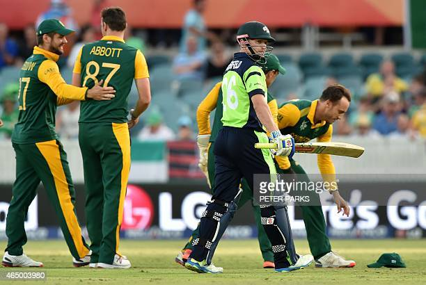 South Africa's players celebrate the wicket of Ireland's William Porterfield during the 2015 Cricket World Cup Pool B match between Ireland and South...