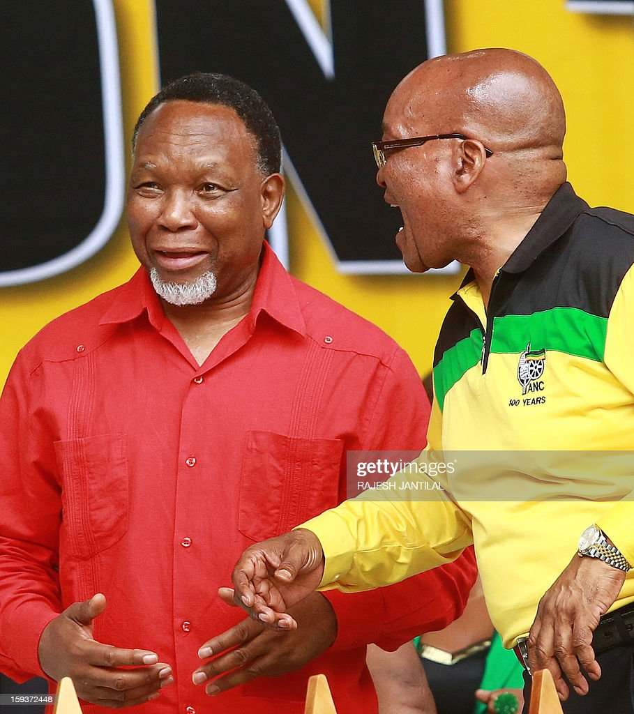 South Africa's President and African National Congress (ANC) leader Jacob Zuma (R) jokes with former ANC Deputy President Kgale Motlanthe during a event commemorating the 101st birthday of the ANC party in Durban on January 12, 2013. Close to 50 000 ANC supporters attend the massive rally to listen Zuma delivering the January 8th statement on behalf of the ANC.