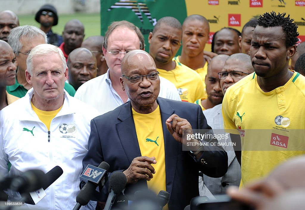 South Africa's President Jacob Zuma flanked by South African football team coach Gordon Igesund (L) and by the team captain Bongani Khumalo (R) talks to journalists on January 15, 2013 at Orlando Stadium in Soweto. Zuma visited today the National Football Team, dubbed the Bafana Bafana at their training camp in Soweto to assure them of the nation's support ahead of the 2013 African Cup of Nations that will take place in South Africa from January 19 to February 10.