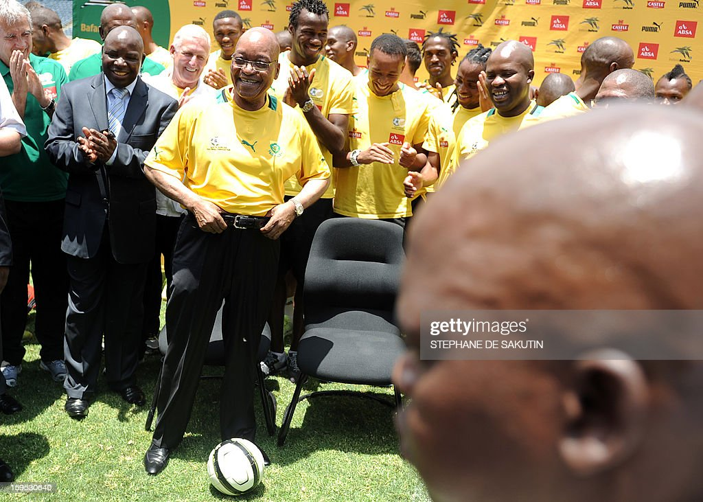 South Africa's President Jacob Zuma poses with a football on January 15, 2013 at Orlando Stadium in Soweto. Zuma has visited today the National Football Team, dubbed the Bafana Bafana at their training camp in Soweto to assure them of the nation's support ahead of the 2013 African Cup of Nations that will take place in South Africa from January 19 to February 10.