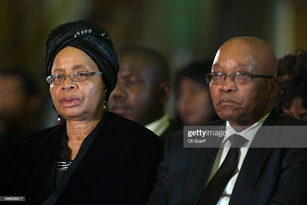 South Africa's President <a gi-track='captionPersonalityLinkClicked' href=/galleries/search?phrase=Jacob+Zuma&family=editorial&specificpeople=564982 ng-click='$event.stopPropagation()'>Jacob Zuma</a> (R) sits with Graca Machel (L), widow of Nelson Mandela, during an African National Congress (ANC) led alliance send off ceremony for former South African President Nelson Mandela at Waterkloof military airbase on December 14, 2013 in Pretoria, South Africa. The ANC held an official send off ceremony as the body of former South African President prepares to make one final journey to his hometown of Qunu for burial. Mr. Mandela passed away on the evening of December 5, 2013 at his home in Houghton at the age of 95. Mandela became South Africa's first black president in 1994 after spending 27 years in jail for his activism against apartheid in a racially-divided South Africa.