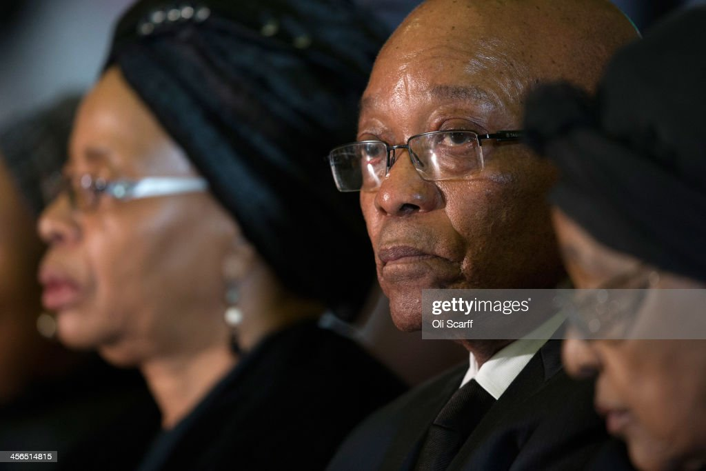 South Africa's President <a gi-track='captionPersonalityLinkClicked' href=/galleries/search?phrase=Jacob+Zuma&family=editorial&specificpeople=564982 ng-click='$event.stopPropagation()'>Jacob Zuma</a> (C) sits with Graca Machel (L), widow of Nelson Mandela, and <a gi-track='captionPersonalityLinkClicked' href=/galleries/search?phrase=Winnie+Mandela&family=editorial&specificpeople=212886 ng-click='$event.stopPropagation()'>Winnie Mandela</a> (R) former wife of Nelson Mandela during an African National Congress (ANC) led alliance send off ceremony for former South African President Nelson Mandela at Waterkloof military airbase on December 14, 2013 in Pretoria, South Africa. The ANC held an official send off ceremony as the body of former South African President prepares to make one final journey to his hometown of Qunu for burial. Mr. Mandela passed away on the evening of December 5, 2013 at his home in Houghton at the age of 95. Mandela became South Africa's first black president in 1994 after spending 27 years in jail for his activism against apartheid in a racially-divided South Africa.