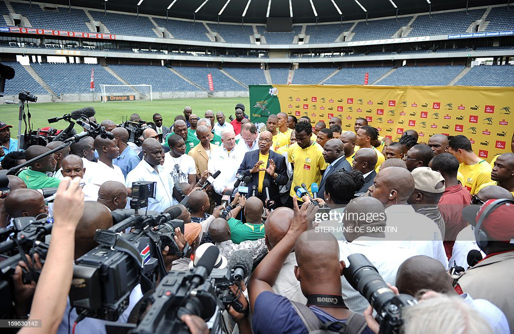 South Africa's President Jacob Zuma talks to journalists on January 15, 2013 at Orlando Stadium in Soweto. Zuma has visited today the National Football Team, dubbed the Bafana Bafana at their training camp in Soweto to assure them of the nation's support ahead of the 2013 African Cup of Nations that will take place in South Africa from January 19 to February 10.