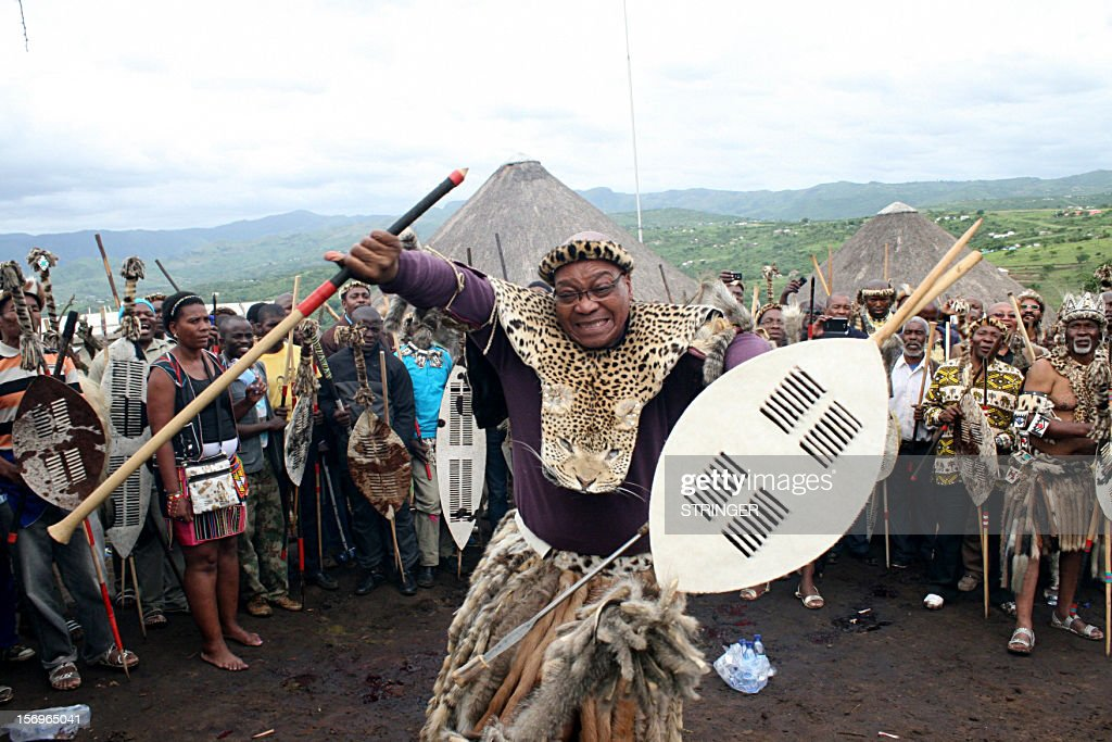 South Africa's President Jacob Zuma's dances during a traditional ritual in Nkandla on November 25, 2012 to help him keep his job. One clan elder calling on the ancestors to protect Zuma against his rivals ahead of an African National Congress (ANC) leadership vote next month. 'We appeal to you all ... ancestors, to be with him, to guide him and protect him against those ganging up against him,' Maqhinga Zuma said at the ceremony in Nkandla where an upgrade to the leader's private home has sparked controversy. AFP PHOTO / Stringer