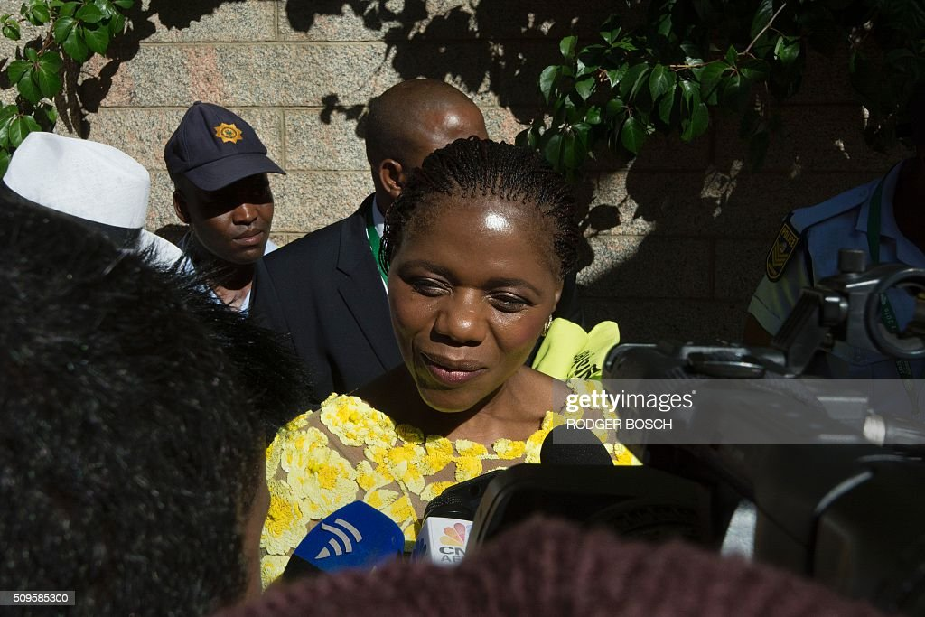 South Africa's Public Protector, Thuli Madonsela, arrives fashionably dressed showing a victory sign, at the annual State of the Nation Address(SONA), at the South African Parliament on February 11, 2016, in Cape Town. Madonsela has been involved in a recent Constitutional Court case with South African President, Jacob Zuma(not visible) who has backed down, and has agreed to pay back the money for the renovation of his private residence at Nkandla. / AFP / RODGER BOSCH