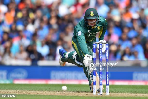 South Africa's Quinton de Kock avoids a runout by India's captain Virat Kohli during the ICC Champions Trophy match between South Africa and India at...
