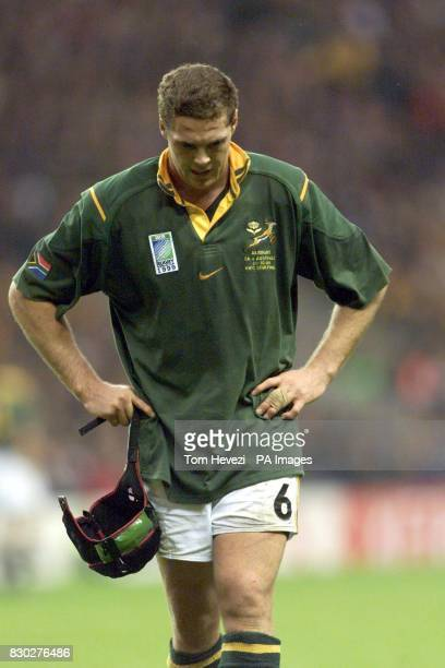 South Africa's Rassie Erasmus walks off the pitch dejected after his side were defeated 2127 by Australia during their Rugby World Cup semifinal...