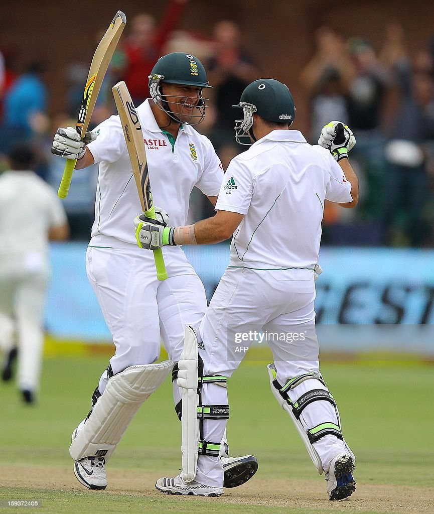 South Africa's Rory Kleinveldt (L) celebrates with teammate Dean Elgar after 100 runs on January 12, 2013 on the second day of the second and final Test against New Zealand at St George's Park in Port Elizabeth. PHOTO /Anesh Debiky