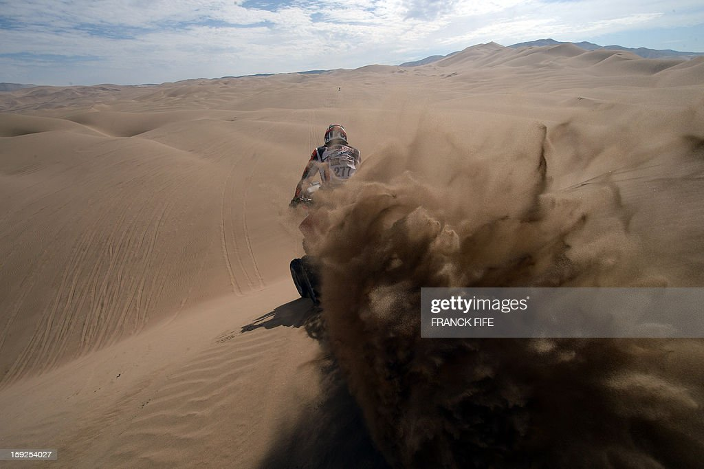 South Africa's Sarel Van Biljon steers his quad during the Stage 6 of the 2013 Dakar Rally between Arica and Calama, Chile, on January 10, 2013. The rally is taking place in Peru, Argentina and Chile from January 5 to 20. AFP PHOTO / FRANCK FIFE